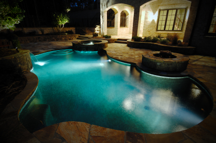 Nightime pool at a luxury home